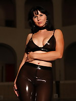 Sexy Desyra Noir dressed in brown plastic pants | DesyraNoir.com